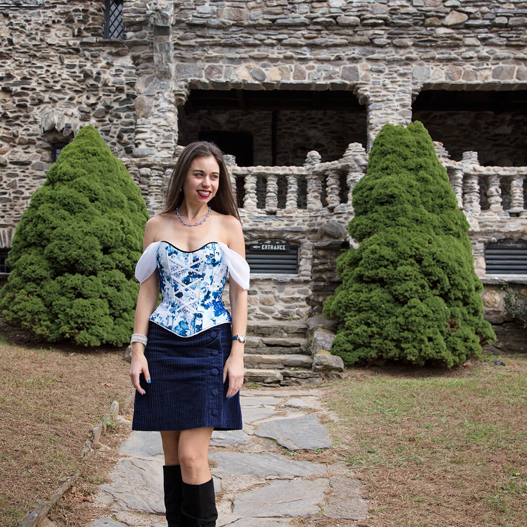 Woman in Off-Shoulder Corset in front of stone building