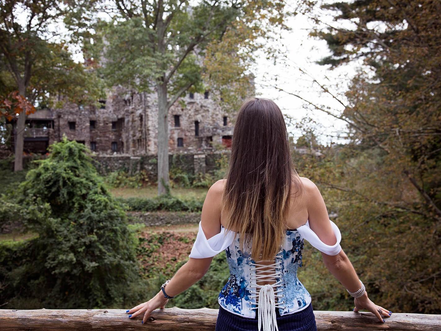 Woman in Off-Shoulder Corset near stone castle
