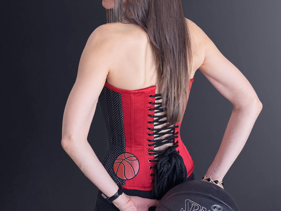 Stella wearing her Chicago Bulls Michael Jordan Corset #23 on black background