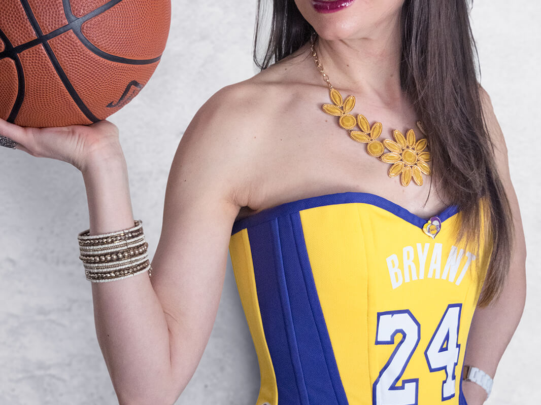 Stella holding basketball wearing Los Angeles Lakers Kobe Bryant Corset #24 on white background