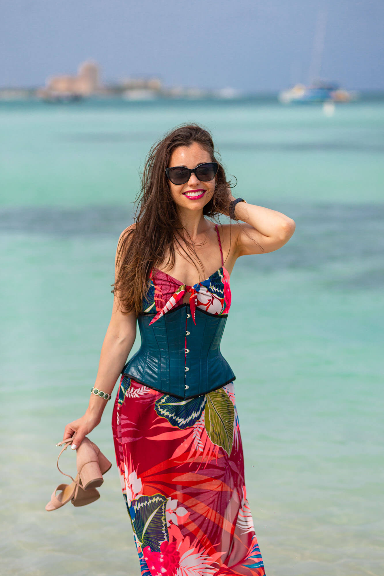 Stella in Teal Corset and Red Tropical Dress near the Ocean