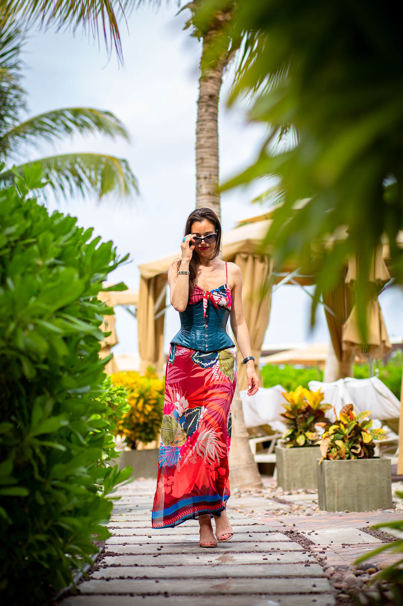 Stella in Teal Corset and Red Tropical Dress at the Beach