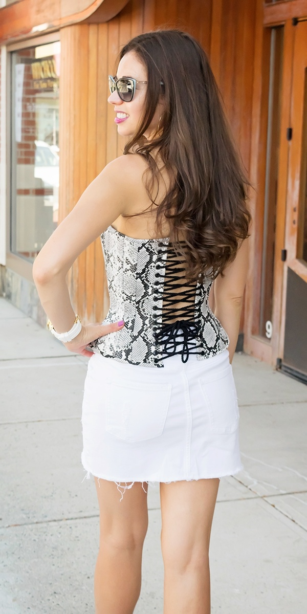 Stella from Champagne Corsets showing the back view of her snake skin corset