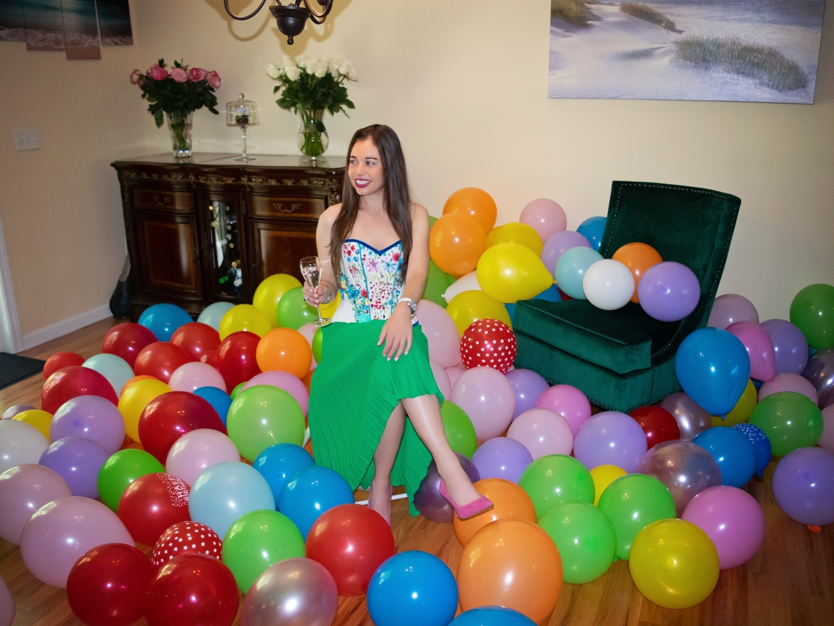 Stella's birthday surrounded by balloons celebrating with champagne.