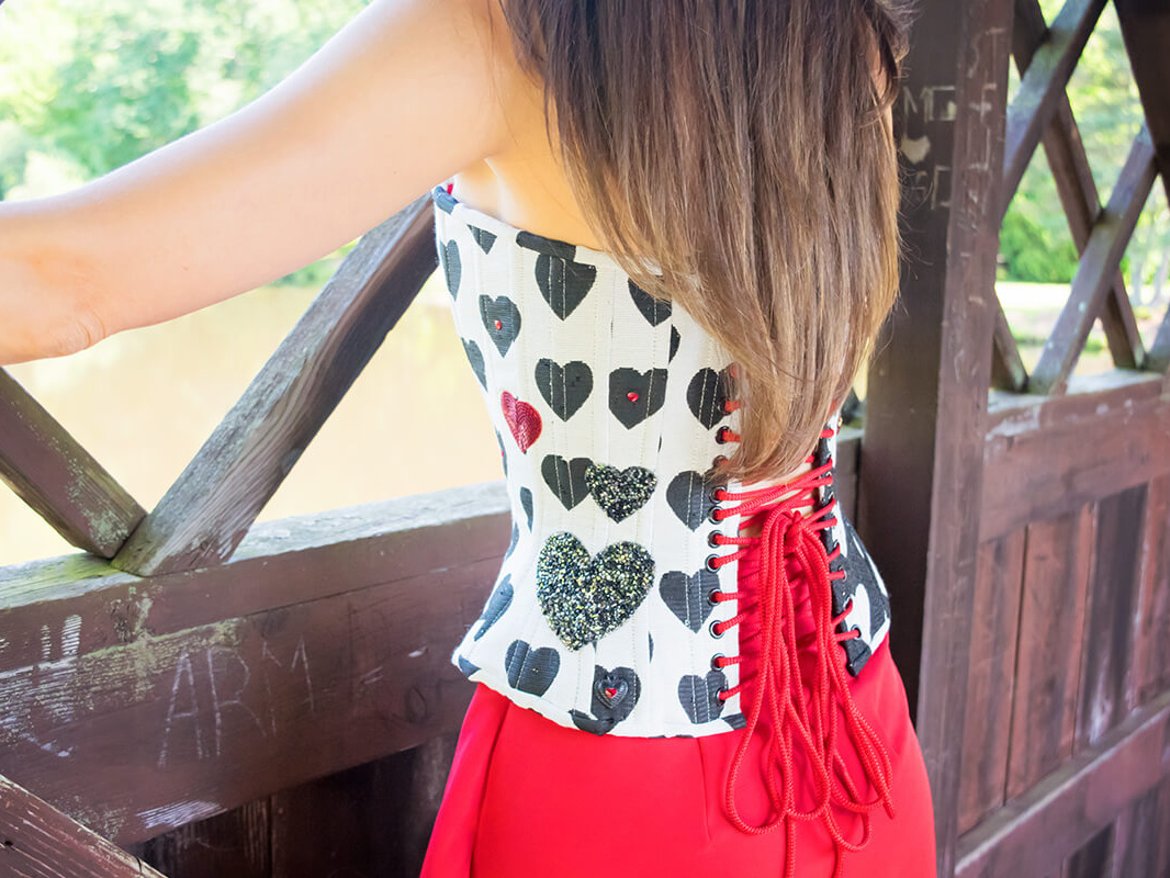 Stella wearing a black and white heart corset